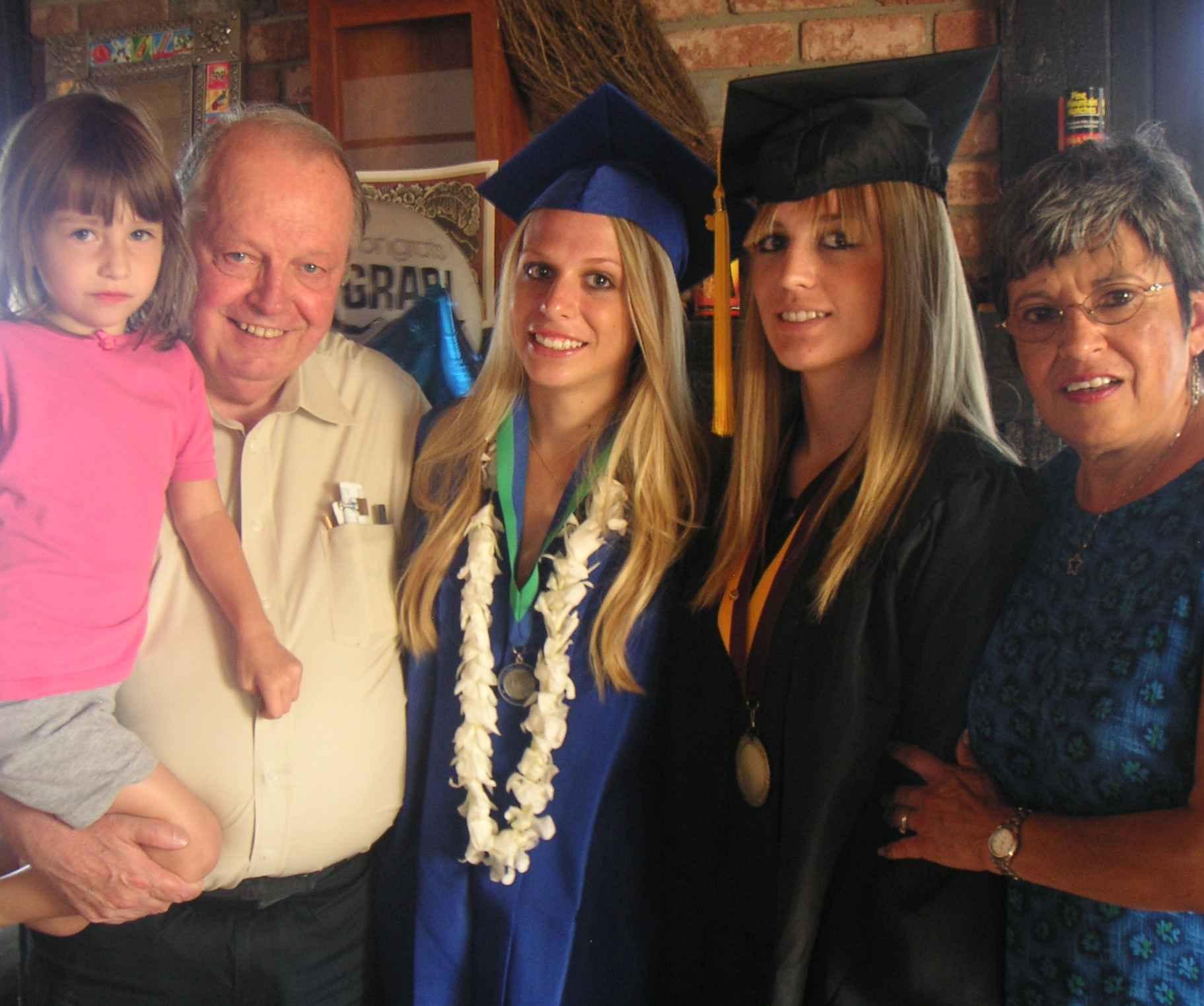 Grandma, grandpa, & the 3 grads